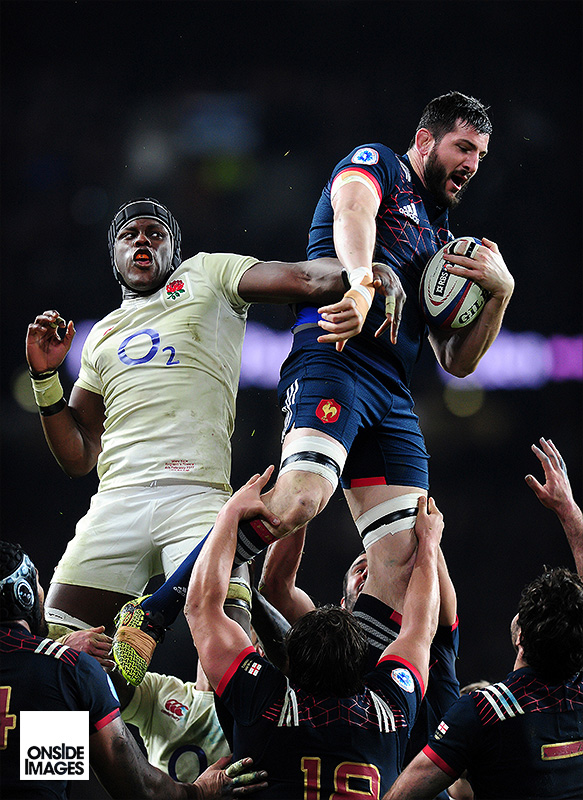 Loann Goujon of France beats Maro Itoje of England for the ball