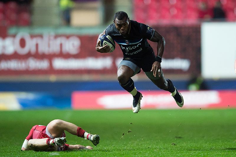 Semesa Rokoduguni takes off against the Scarlets