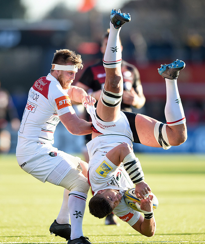 Mike Williams of Leicester Tigers is upended after winning the ball in the air