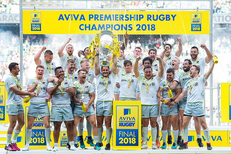 Saracens celebrate as Brad Barritt lifts the Aviva Premiership trophy